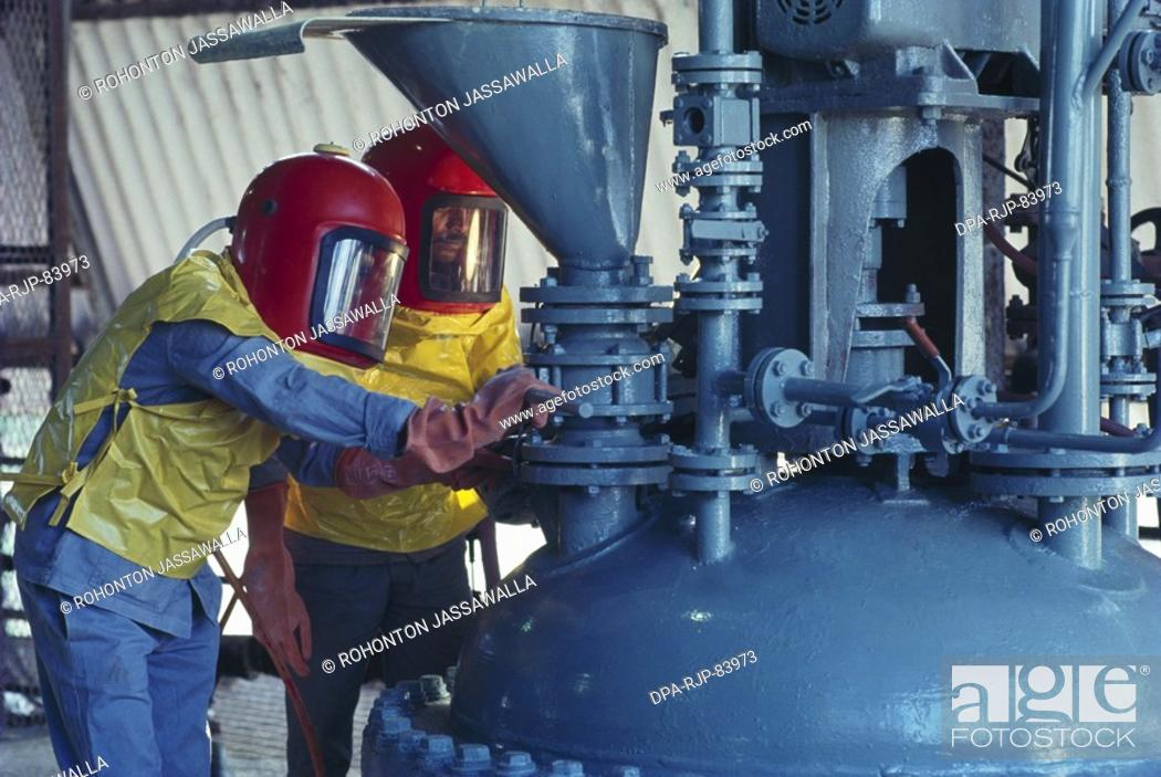 Stock Photo: men working in chemical plant , india.