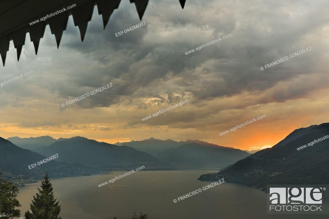 Photo de stock: Sunrise in front of Lake Maggiore in the beautiful town of Cannobio, Italian comune of the province of Verbano-Cusio-Ossola, Piedmont region.