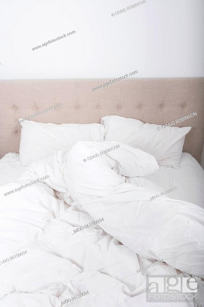 Stock Photo: Messy bed in bedroom.