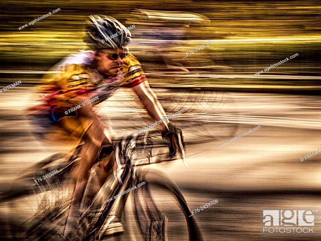 Stock Photo: Pan shot of man on bicycle, Central Park, NYC, USA.