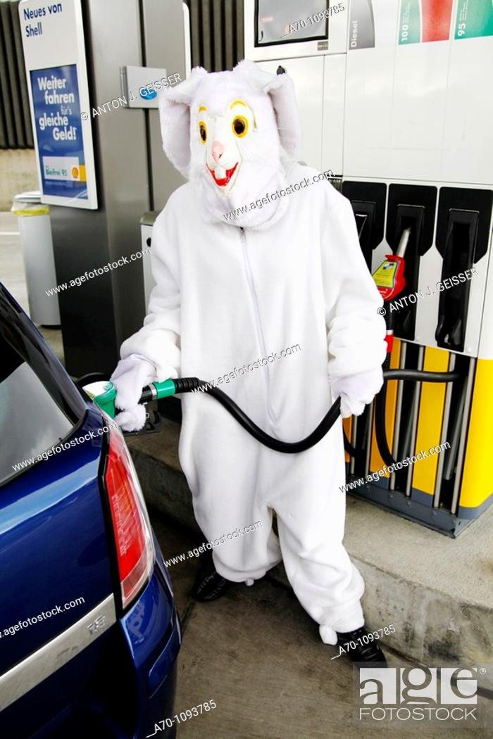 Stock Photo: Man in easter bunny costume at gas station.