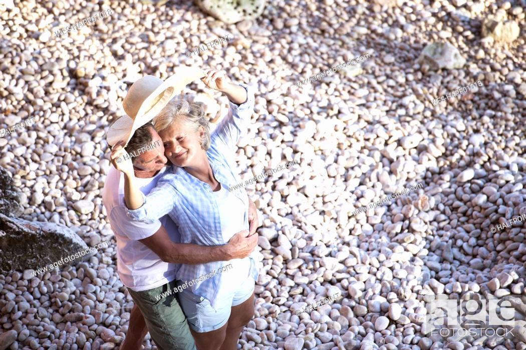 Stock Photo: Top view of senior couple on the beach.
