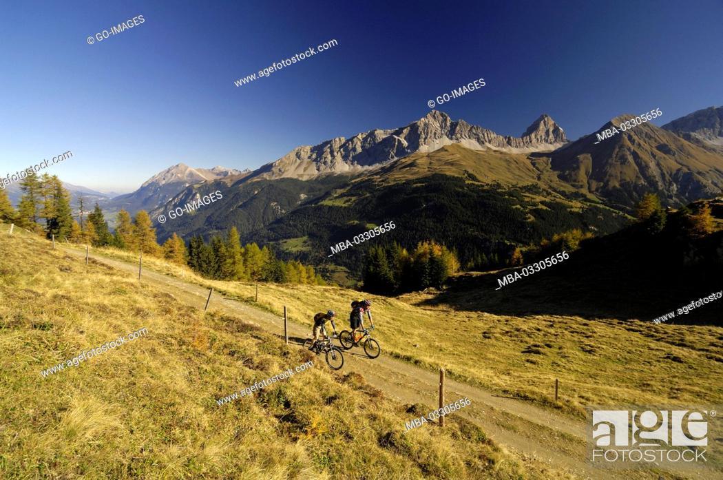 Stock Photo: Mountain biker near Svognin, Canton of Grisons, Switzerland,.