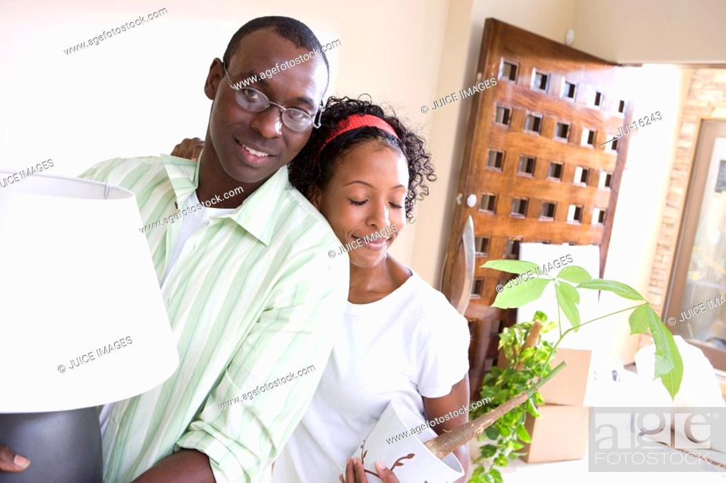 Stock Photo: Couple hugging in new home.