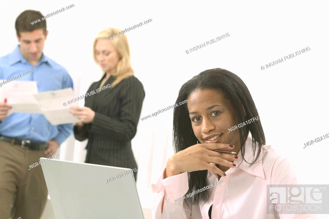 Stock Photo: Woman in Pink Shirt in Front of Laptop.