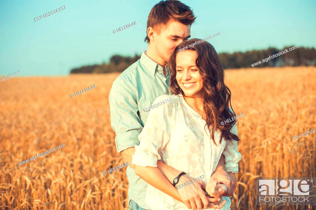 Stock Photo: Young couple in love outdoor. Stunning sensual outdoor portrait of young stylish fashion couple posing in summer in field.