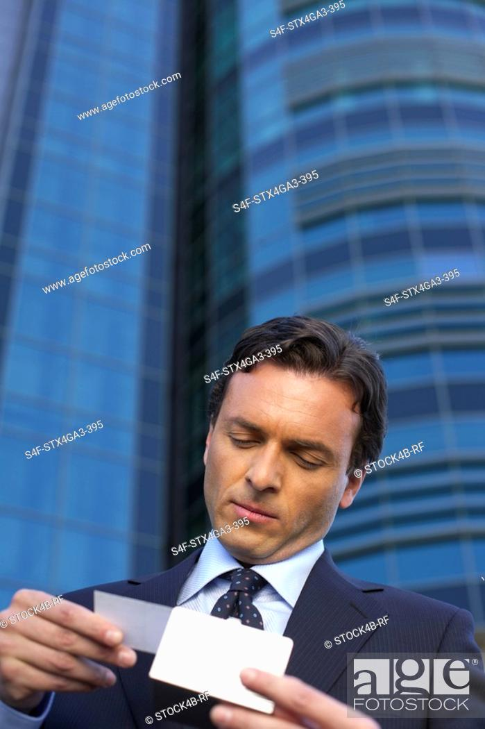 Stock Photo: Businessman watching a business card.