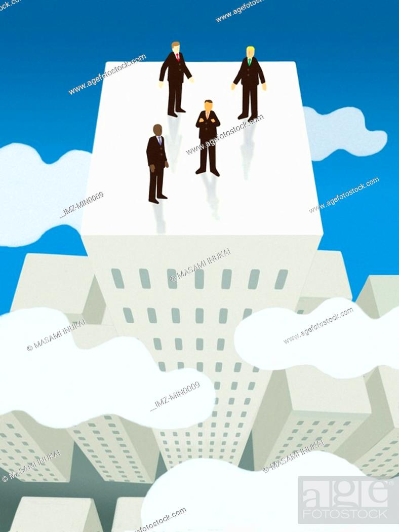 Stock Photo: Four businessmen standing on top of the tallest building above the clouds.