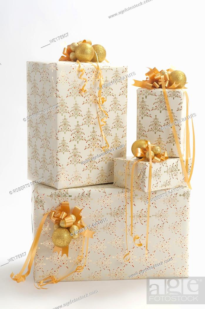 Stock Photo: Four gift box with toys isolated on white background.