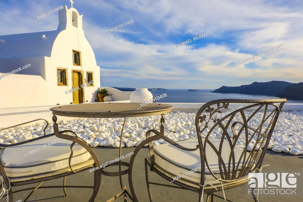 Stock Photo: Church and terrace. Oia. Santorini. Cyclades islands. Greece.