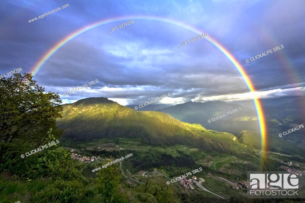 Imagen: Rainbow on Gresta Valley and Mount Biaena. Trento province, Trentino Alto-Adige, Italy, Europe.