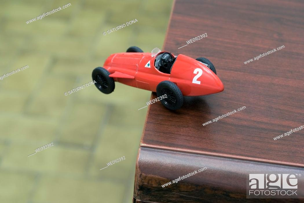 Stock Photo: racing car in dangerous situation.
