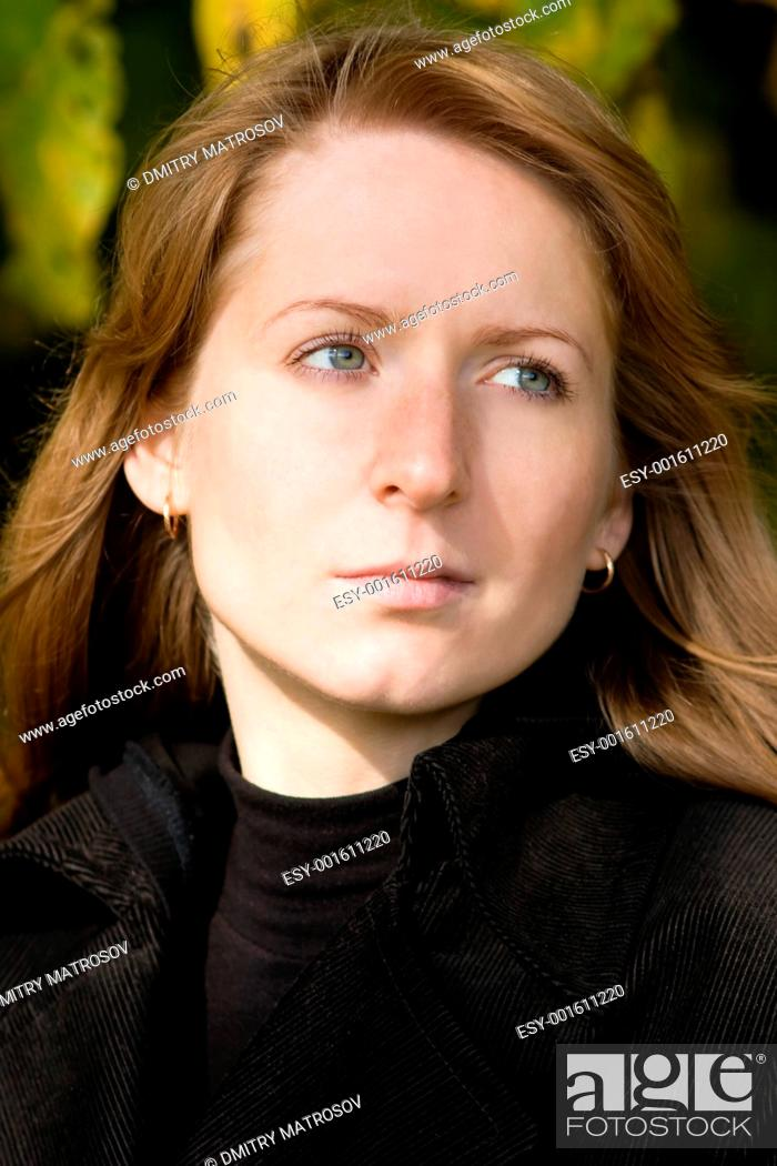 Stock Photo: Portrait of beautiful woman in a park. 2.