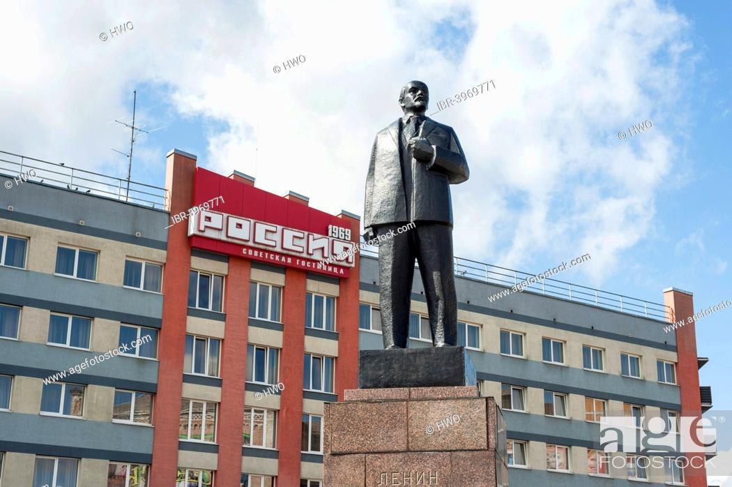 Lenin monument, bronze, on a stone pedestal, Hotel Russia at