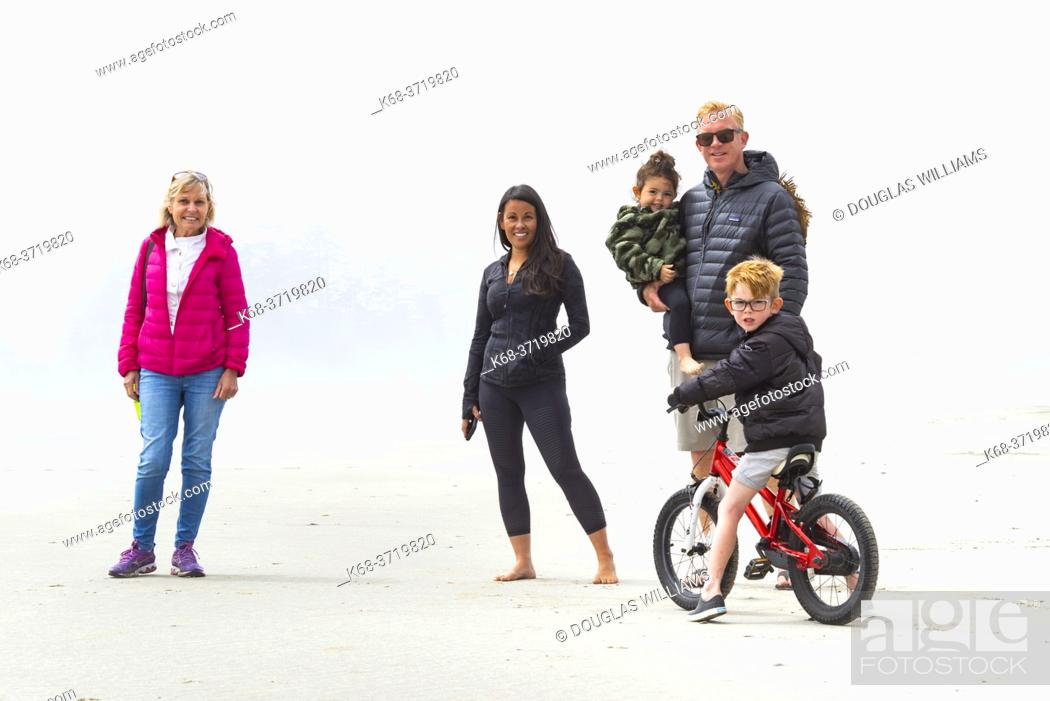 Stock Photo: Family on the beach, in fog, near Tofino, British Columbia, Canada.