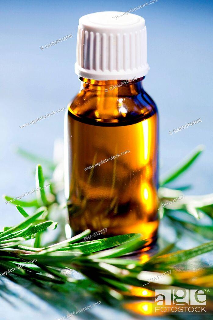 Stock Photo: Bottle of rosemary essential oils.