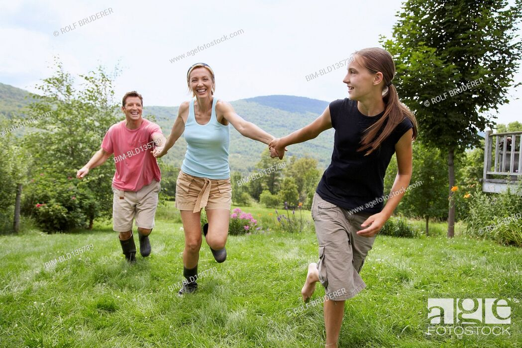 Stock Photo: Family walking together in backyard.
