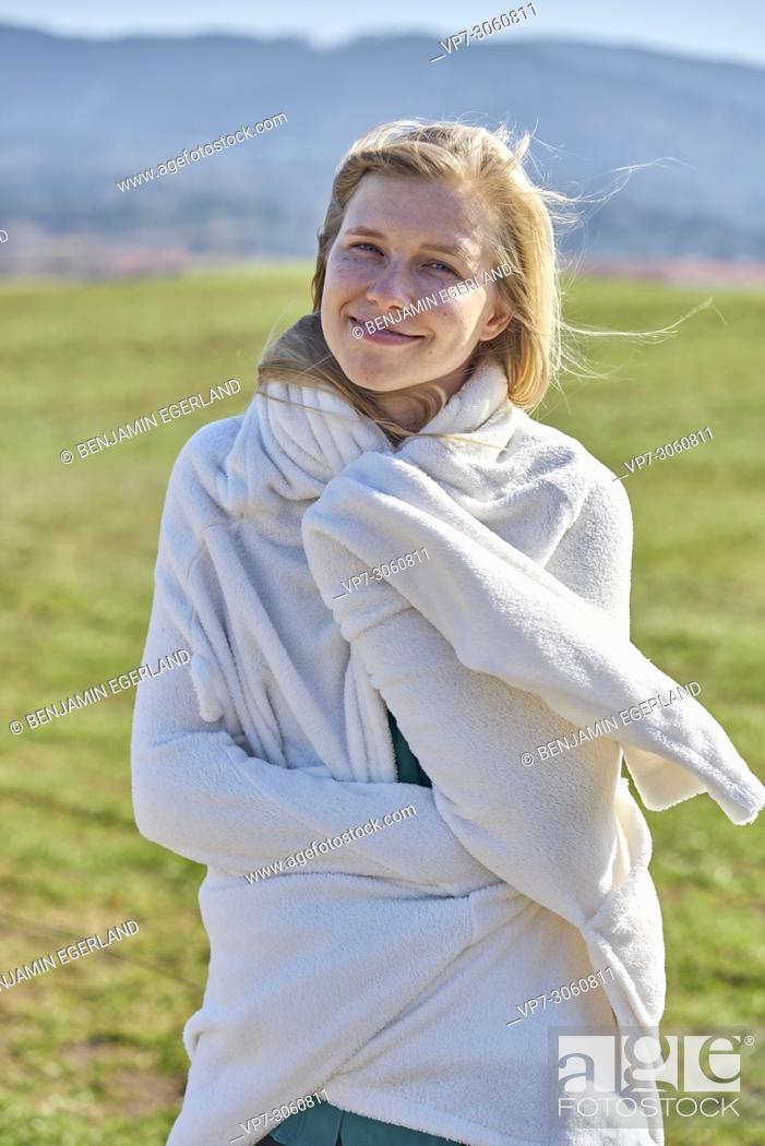 Imagen: Portrait of woman in nature wearing a white bathrobe. Waakirchen, Bavaria, Germany.