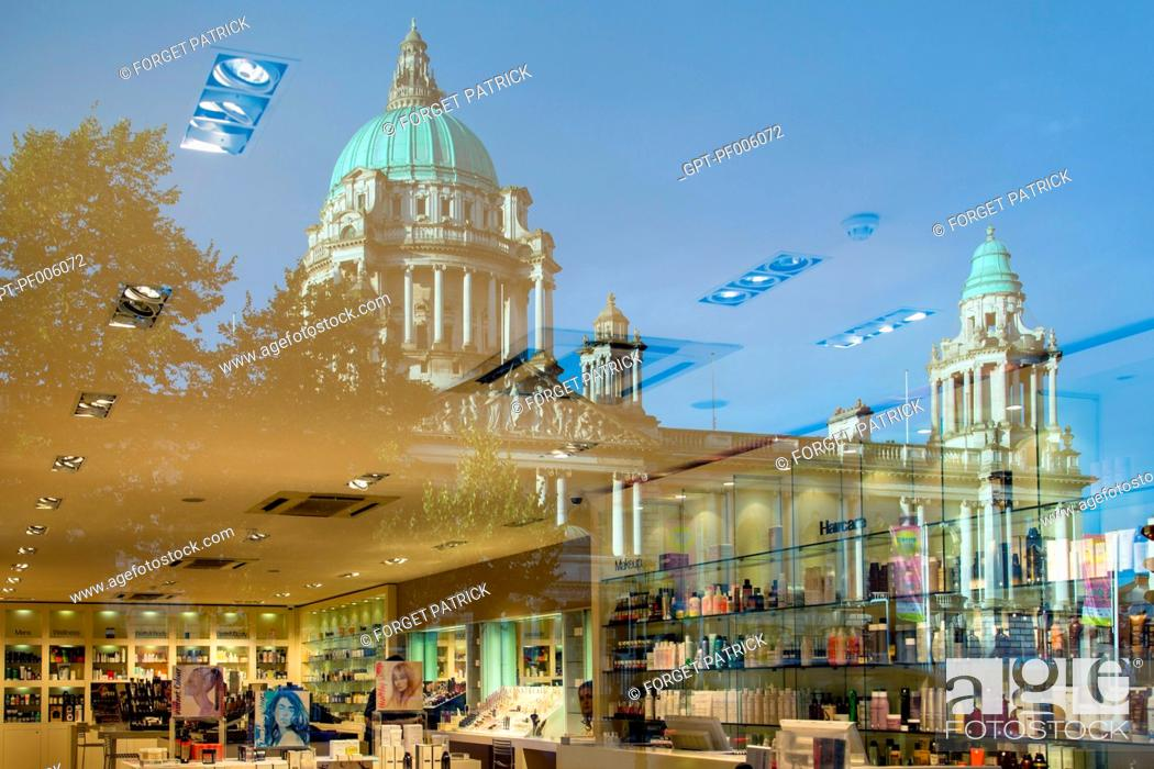 Stock Photo: REFLECTION OF THE BELFAST CITY HALL IN A COSMETICS SHOP, DONEGALL SQUARE EAST, BELFAST, ULSTER, NORTHERN IRELAND.