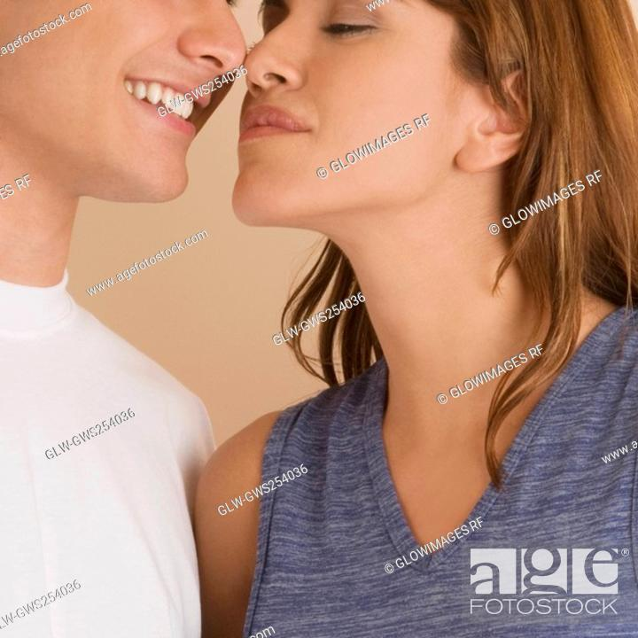 Stock Photo: Close-up of a young couple rubbing their noses.