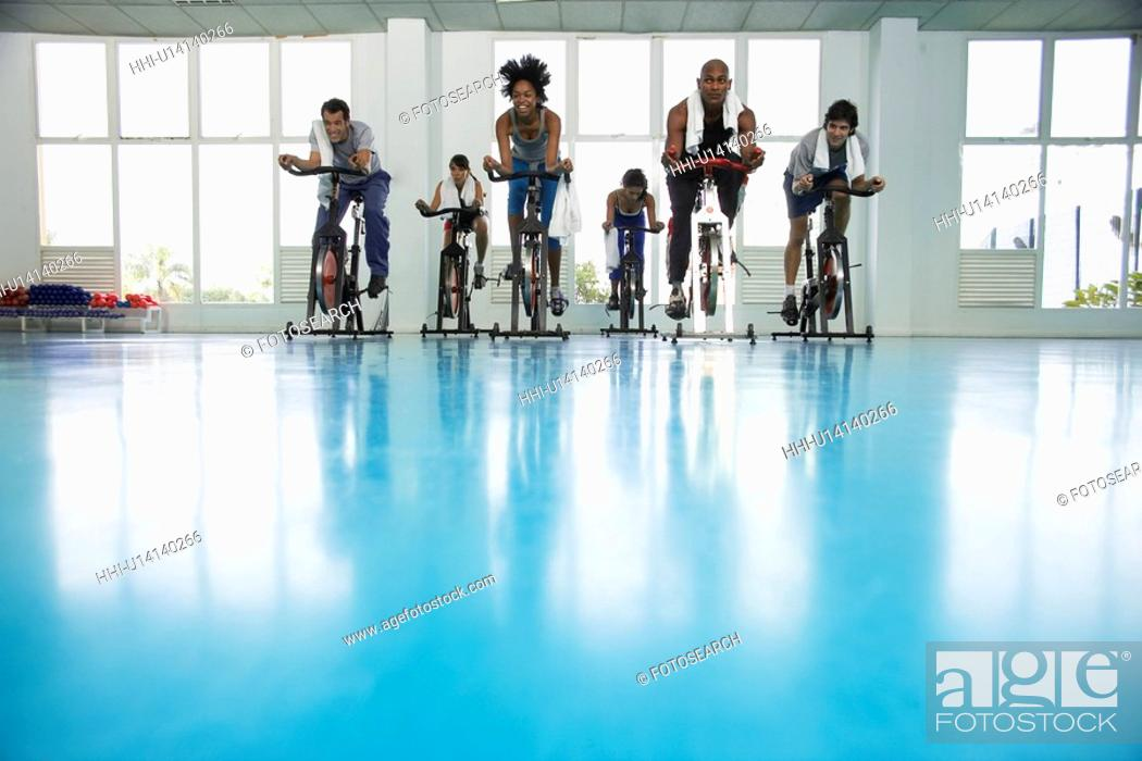 Stock Photo: Group indoor cycling.