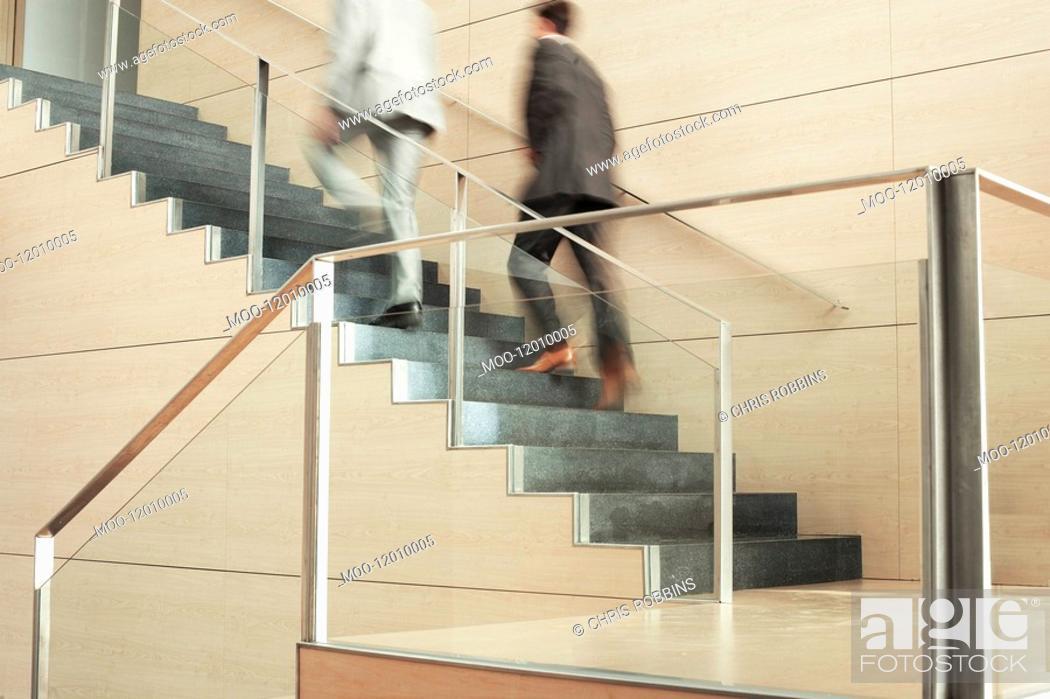 Stock Photo: Businessmen Climbing Stairs.