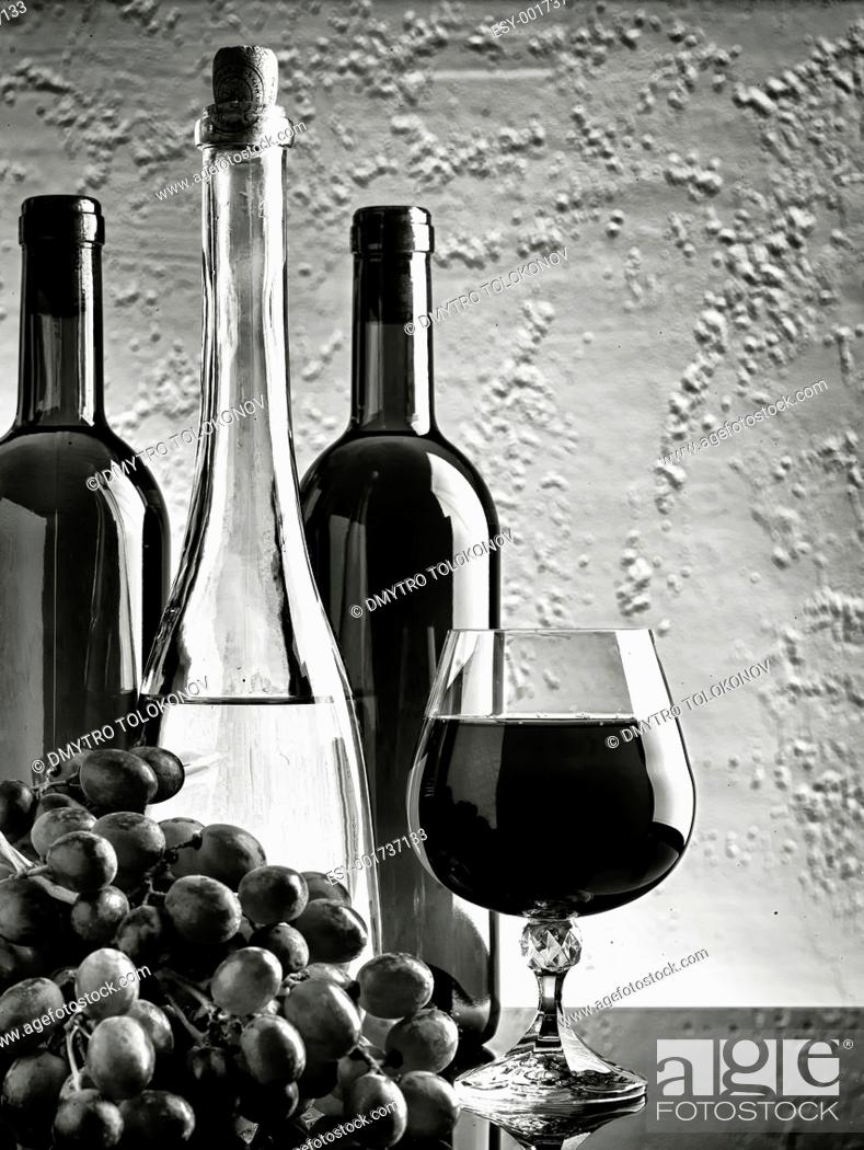 Stock Photo: Black and white HDR still-life with wine bottles and grape.
