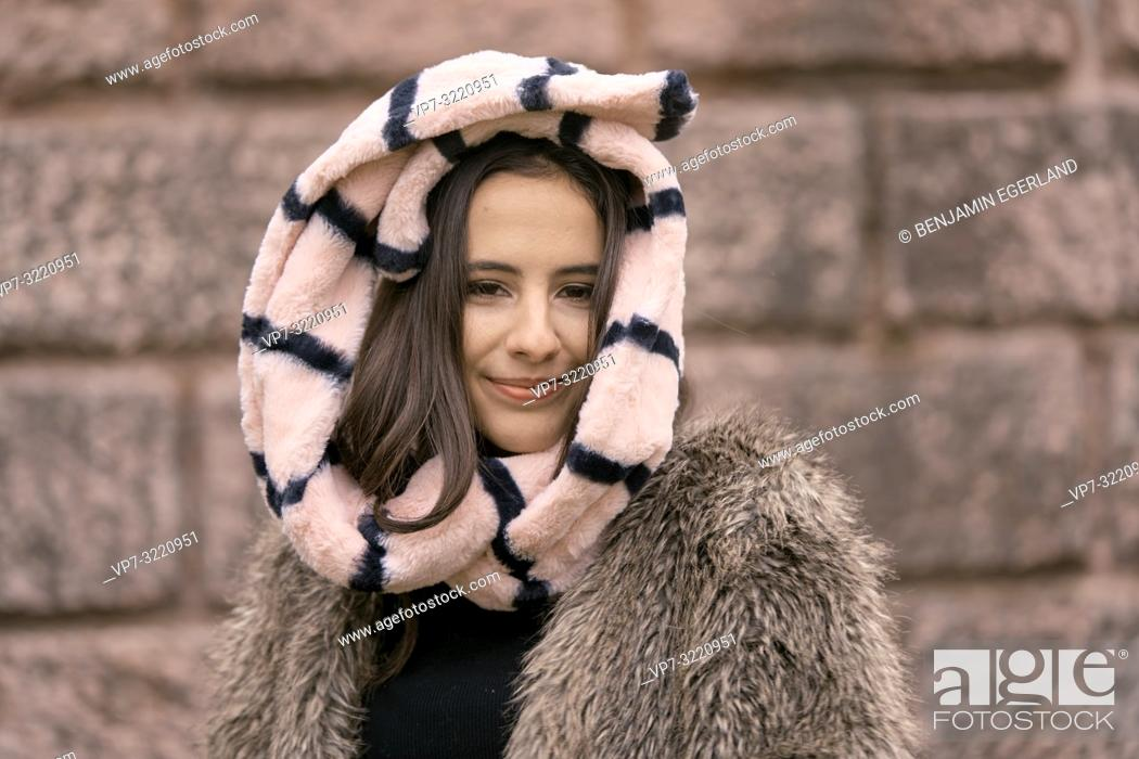 Stock Photo: vital woman head enveloped in scarf, playful positive, cold temperatures, happiness, content, in Munich, Germany.