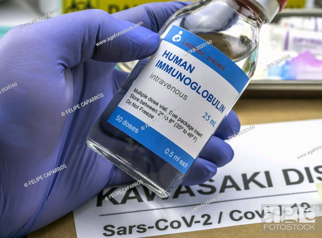 Stock Photo: Nurse hold human immunoglobulin vial generic drug to treat Sars-CoV-2-related Kawasaki disease in children under five, conceptual image.