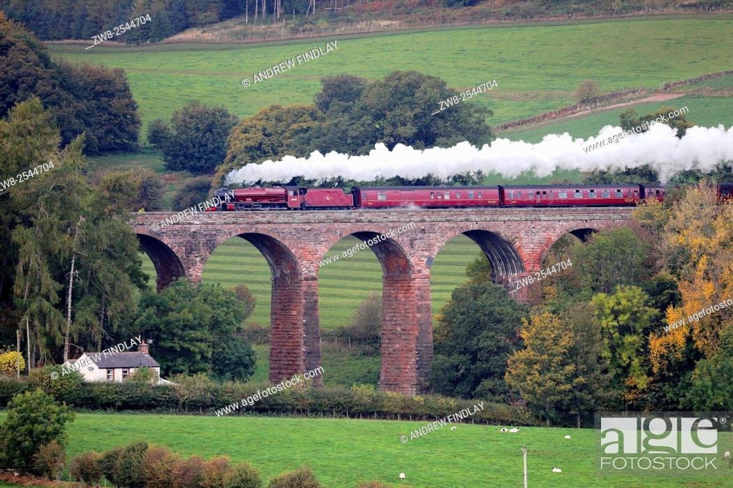Stock Photo: LMS Jubilee Class 45699 Galatea 'The Cumbrian Mountain Express', steam train on the Settle to Carlisle Railway Line. Dry Beck Viaduct, Armathwaite, Eden Valley.
