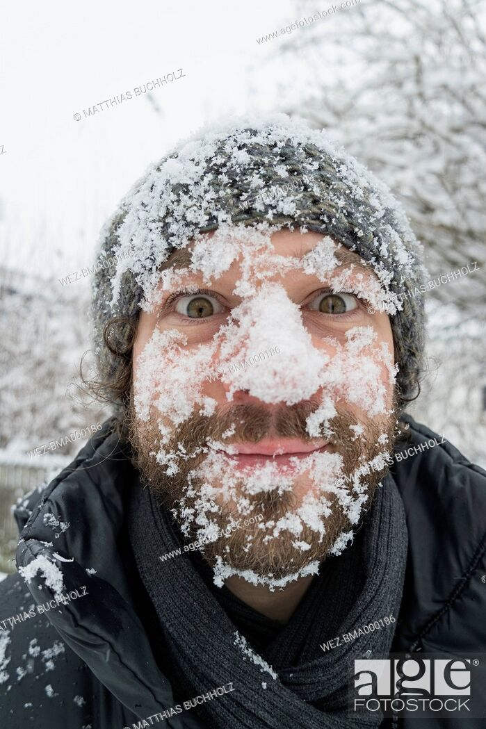 Stock Photo: Portrait of man with snow in his face.