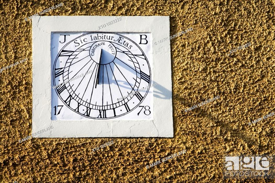 Stock Photo: Sundial with Motto SIC LABITUR AETAS So Goes Life in Middleham North Yorkshire England.