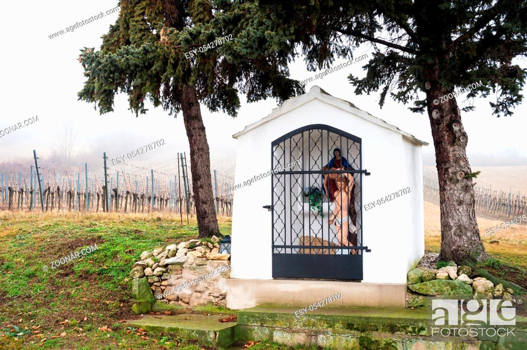 Stock Photo: Small chapel with statue of jesus in burgenland.
