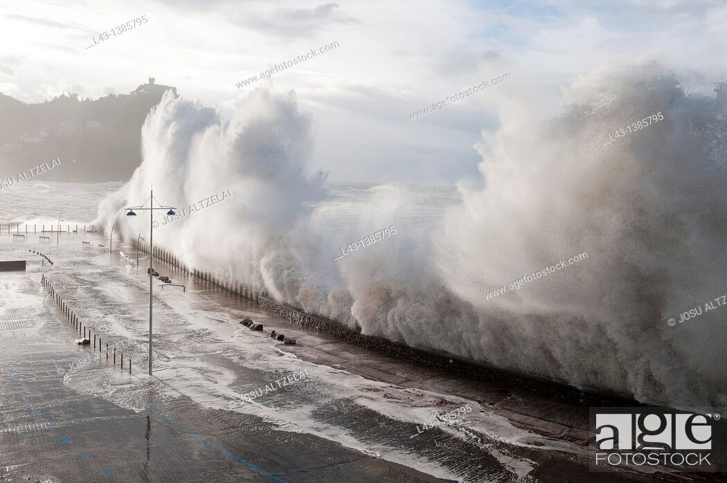 Stock Photo: Waves breaking in a storm in San Sebastian, Basque country.