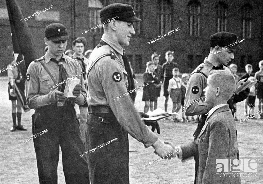 Stock Photo: A ten-year-old boy is admitted to the German Youth, the youth organization of the Hitler Youth (DJ) for 10 to 14-year-old boys, on 19 April 1943, in Berlin.