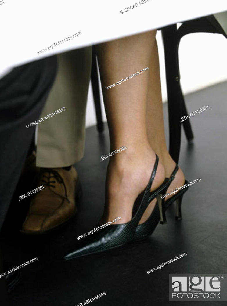 Stock Photo Female Legs Under Table In Restaurant