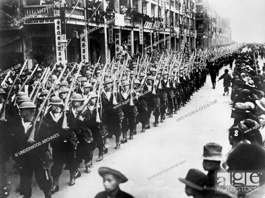 Stock Photo: Hong Kong, China: April 8, 1927. British Bluejackets marching through the Chinese quarter of Hong Kong in a show of strength as they try to quell the unrest.