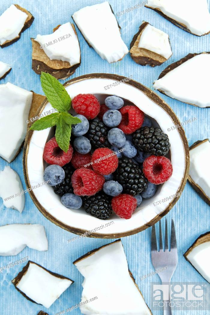Stock Photo: Coconut with berries.