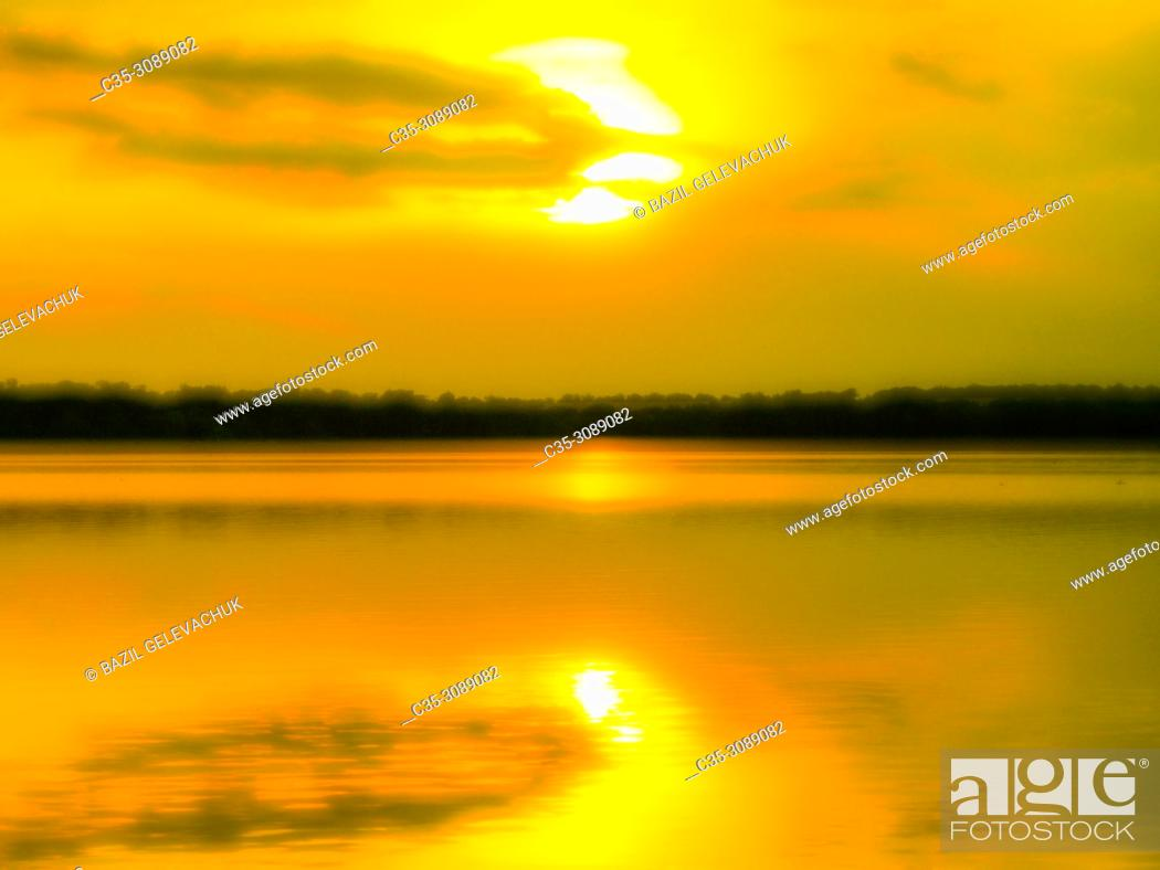 Stock Photo: sunset on the river is photographed with a monocle.
