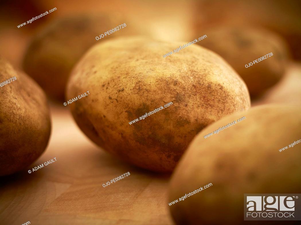 Stock Photo: Close up of organic potatoes.