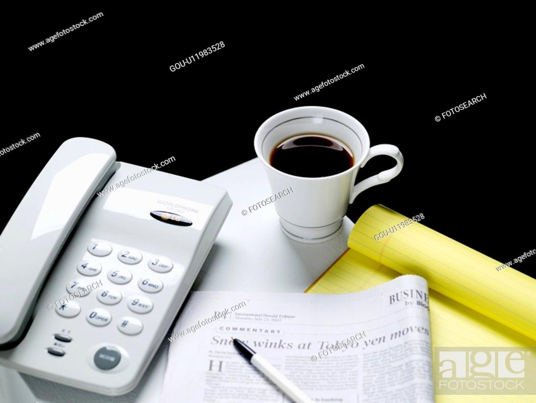 Stock Photo: ball-point pen, newspaper, notebook, telecommunication, telephone, food, coffee cup.