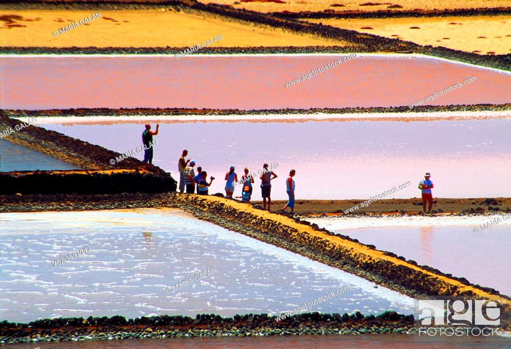 Stock Photo: Group of tourists visiting the salt works. Salinas de Janubio Nature Reserve, Lanzarote, Canary Islands, Spain.