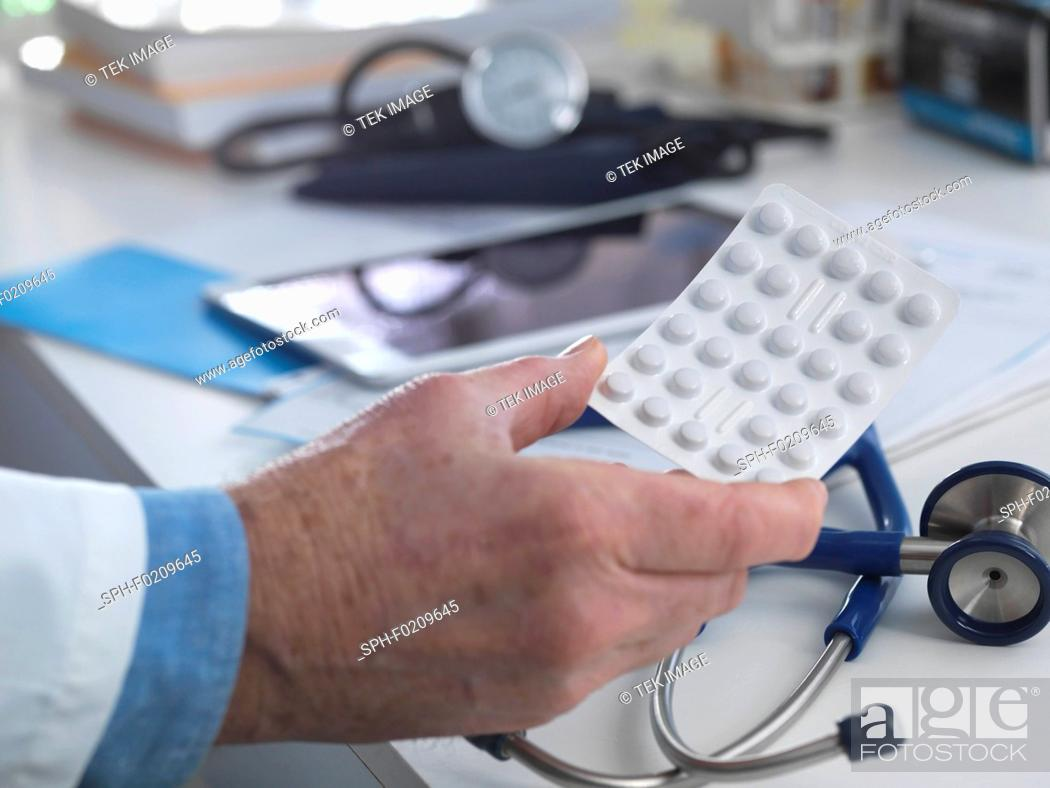 Stock Photo: Doctor with tablets.