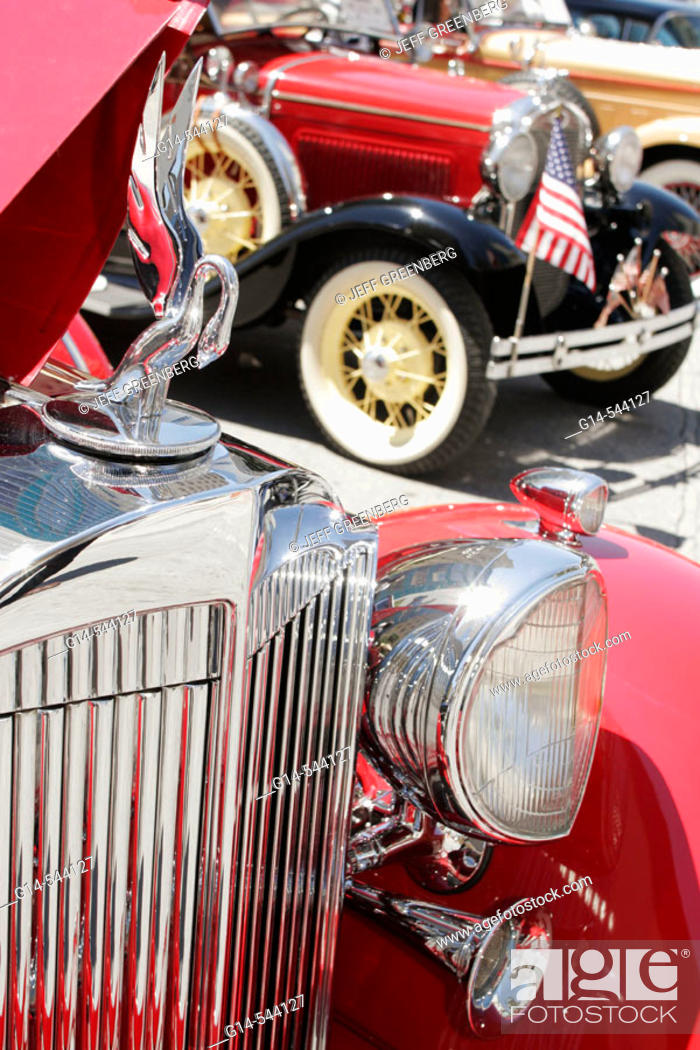 Stock Photo: Classic Car Show, antique Packard, automobile, red, hood ornament, swan, chrome grille. Flagler Street. Miami. Florida. USA.