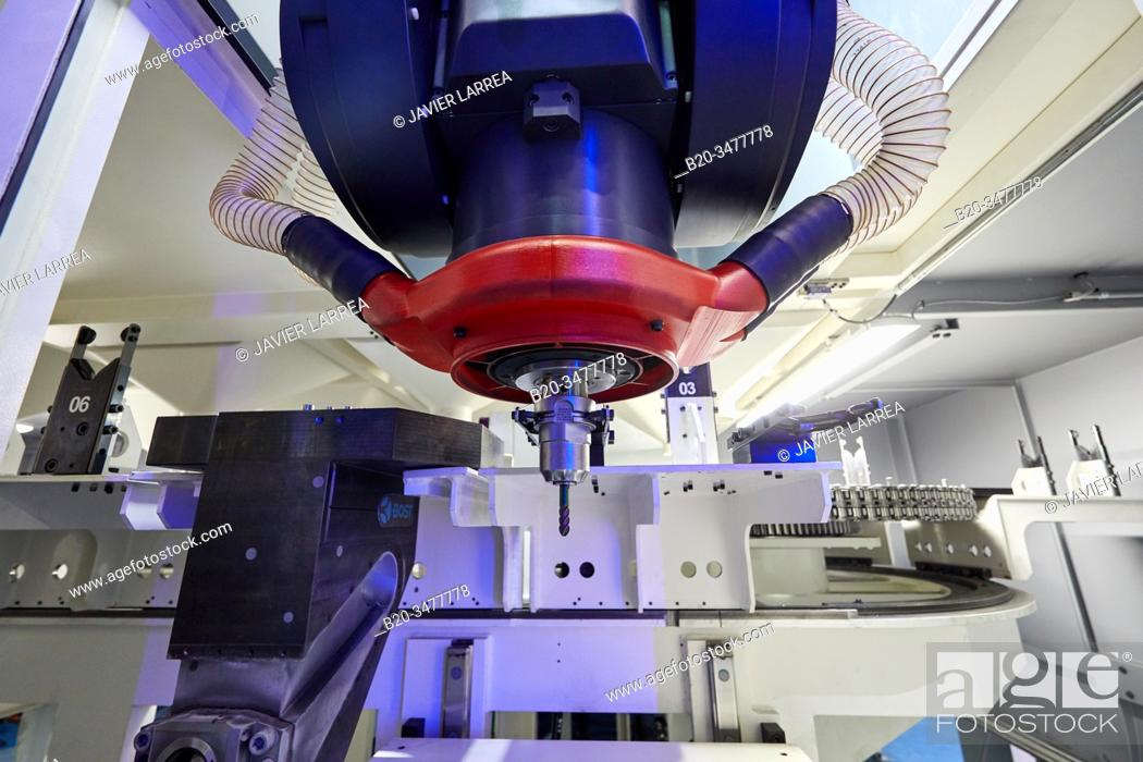 Stock Photo: Tool changer, Machining Centre, CNC, Vertical turning and Milling lathe. Design, manufacture and installation of machine tools, Metal industry.