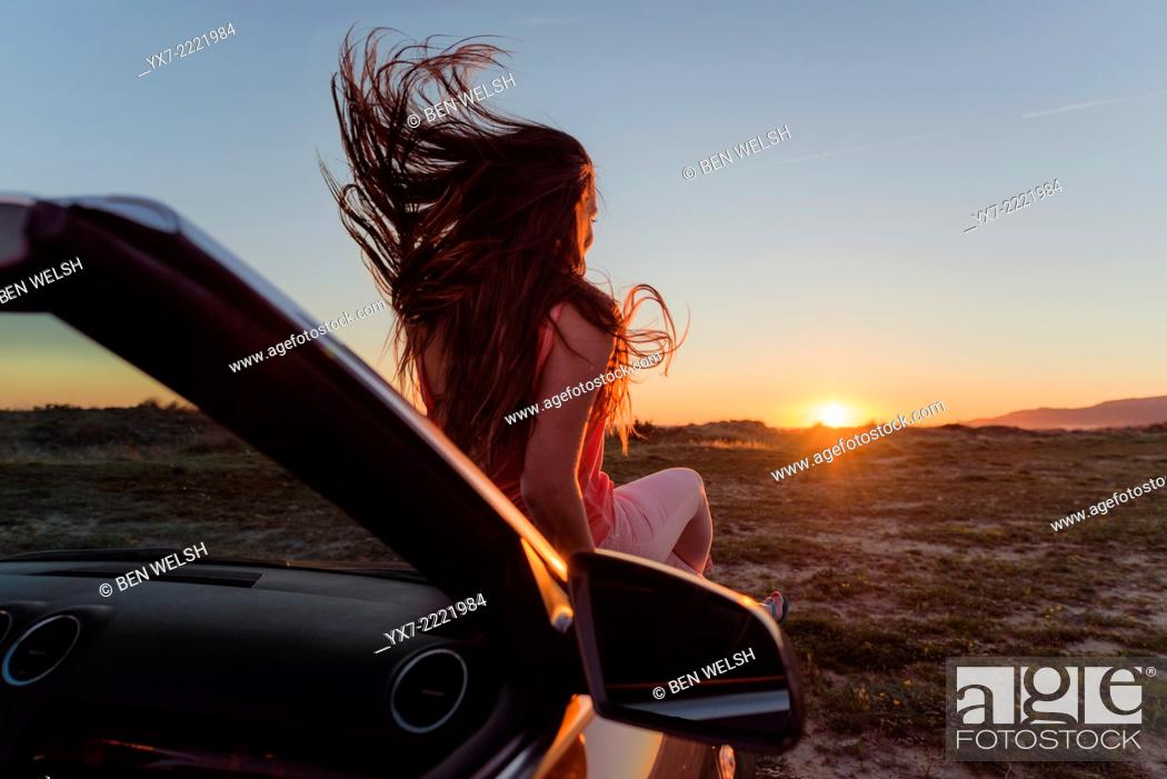Imagen: Young woman in a convertible car. Tarifa, Cadiz, Andalusia, Spain, Europe.