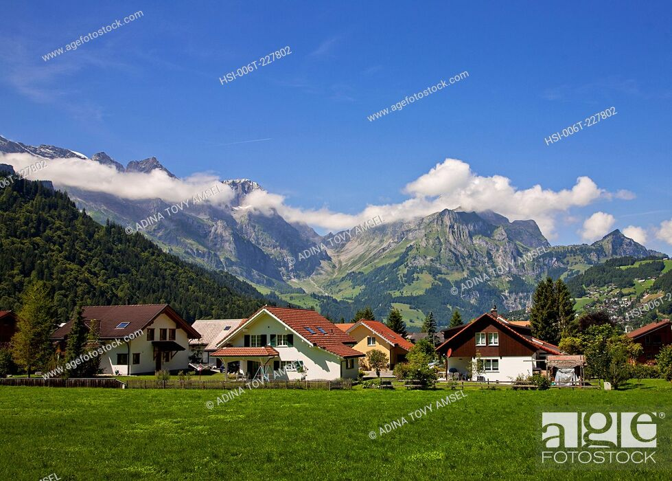 Stock Photo: Europe. Switzerland. Engelberg. View of houses at edge of town.