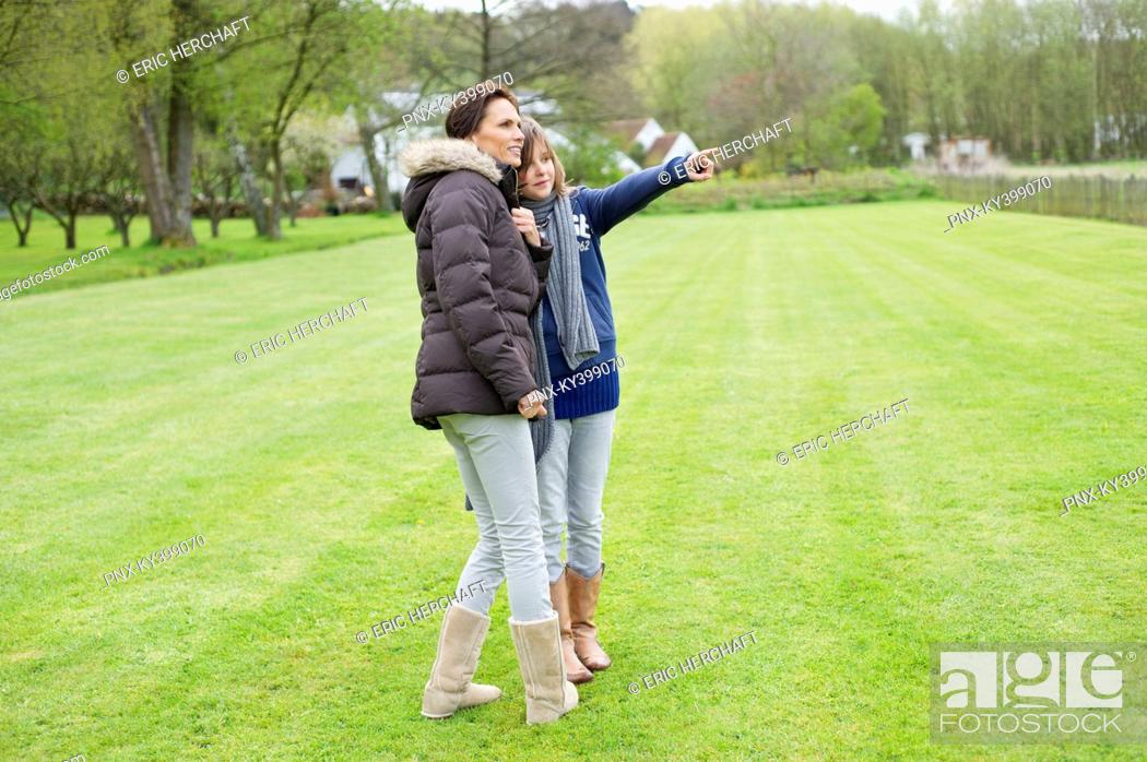Stock Photo: Woman with her daughter in a park.