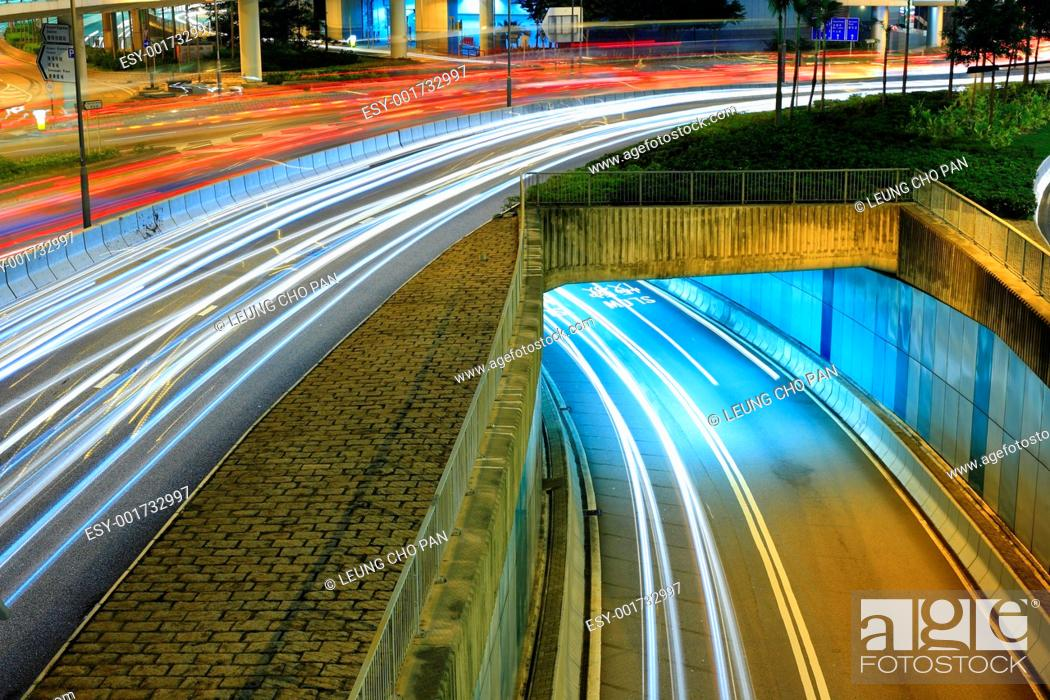 Photo de stock: Highway in city at night with trails of car lights.