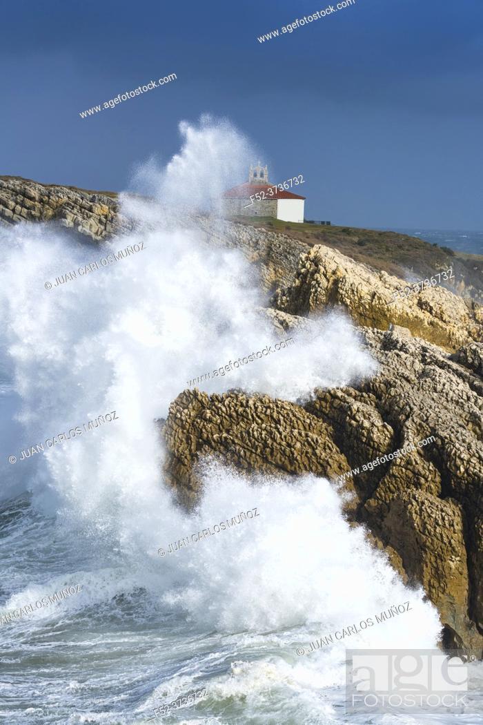 Stock Photo: Swell and storm in the Hermitage of the Virgen del Mar in San Roman de la Llanilla in the Municipality of Santander. Virgen del Mar Island in the Cantabrian Sea.